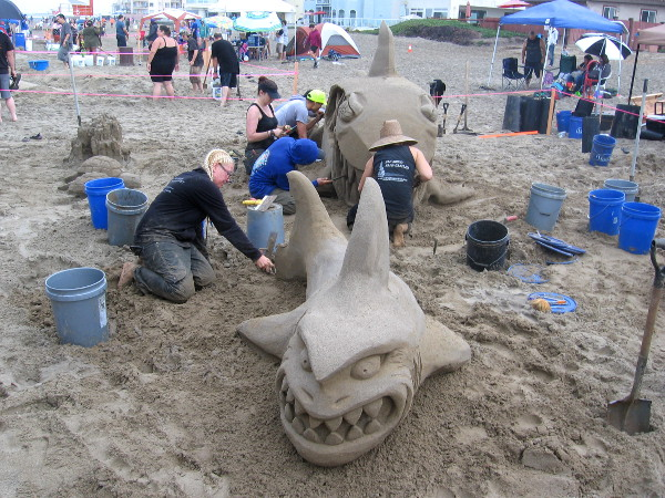 San Diego Sand Castles was skillfully carving toothy land sharks.