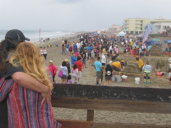 A cloudy, showery day with lightning, thunder and crowds on the beach enjoying a cool Imperial Beach tradition.