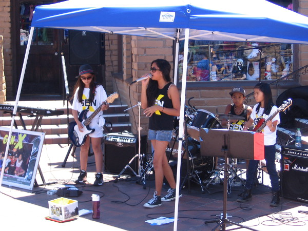 These talented kids playing classic rock tunes in Seaport Village form the band Gen-X!