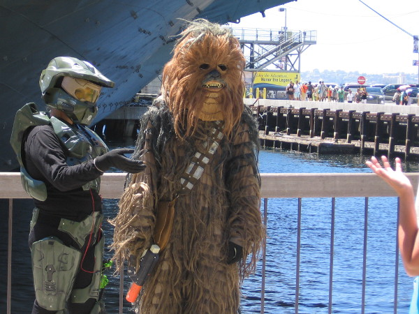Chewbacca is hanging out with a Star Wars buddy near the USS Midway Museum.