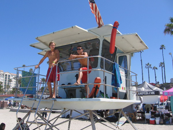 A couple of lifeguards watch the huge crowd from their tower on Oceanside's always popular beach.