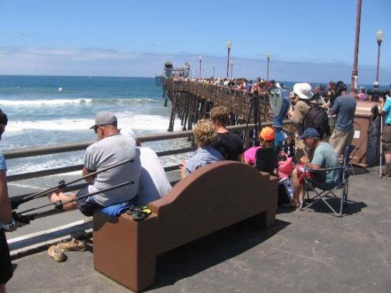 And hundreds are watching from up on the pier, as well.