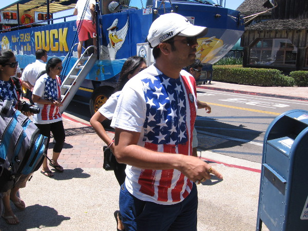 Tourists wearing Old Glory have disembarked from a San Diego SEAL Tours cool Hydra-Terra vehicle at Seaport Village.