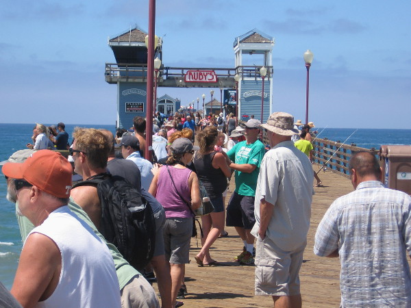 Guys on the other side of the pier seem more interested in fishing.