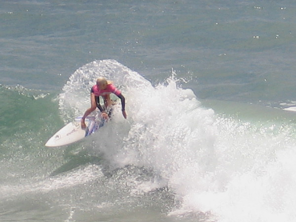 Cool photo of today's surfing champion shredding the crest of a wave.