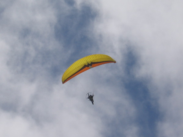 Now this person had the best view of all. A paraglider soars quietly above!
