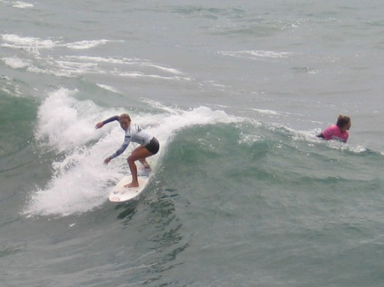 Two competitors duel, trying their best to advance in the 2015 Supergirl Pro in Oceanside, California.