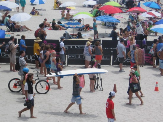 Blogging about an awesome surf event requires a photo of someone walking along with a surfboard on their head!