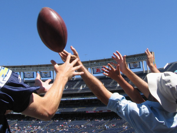 A kicked football flies into the stands during the 2015 Chargers FanFest.