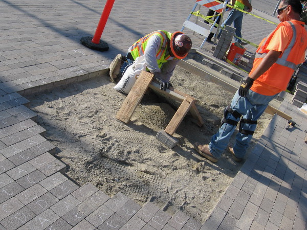 Workers have begun to install the first paver bricks dedicated to people, businesses or organizations at the foot of San Diego's Broadway Pier.