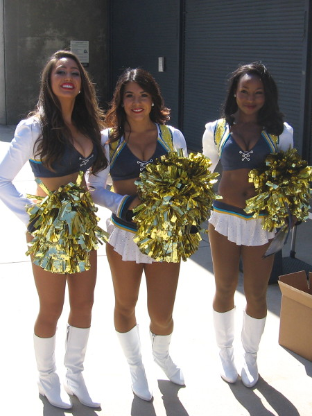 San Diego Charger Girls cheerleaders smile as fans enter Qualcomm Stadium for FanFest.