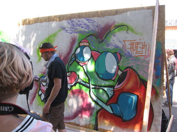 Artist creates live street art during 2015 CityFest in Hillcrest.