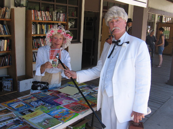 Mark Twain uses his cane to point out his classic novel The Adventures of Tom Sawyer. Many 19th century authors and fictional characters were seen walking about during TwainFest.