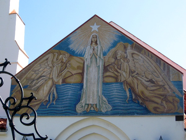 Classic religious imagery floats above entrance to Mary, Star of the Sea Catholic Church in La Jolla.