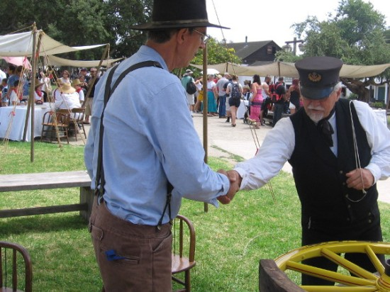 A ship's purser greets the friendly wheelwright in Old Town San Diego State Historic Park during Stagecoach Days: Trades That Shaped the West.
