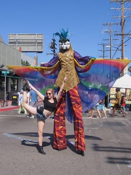 I don't know the name of this tall guy with the rainbow wings and multiple carnival mask faces. Lots of people were posing for photographs.