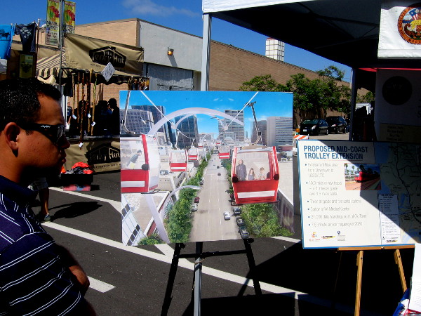 Conceptual art displayed by County of San Diego Supervisor Ron Roberts at CityFest shows proposed aerial skyway from downtown to Balboa Park.