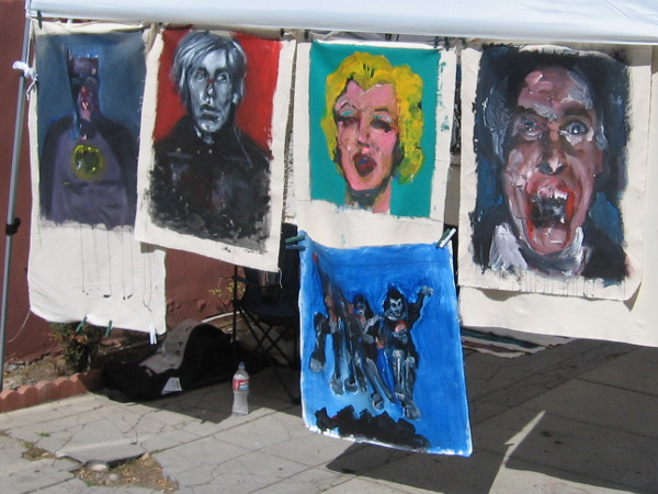 I see Batman and Marilyn Monroe, among other boldly painted faces.