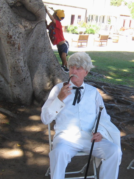 Mr. Samuel Clemens, American author of many famous books and stories, relaxes under a tree in Old Town San Diego State Historic Park during 2015 TwainFest.