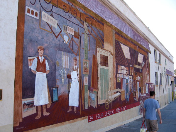 The Loading Dock is a large public mural painted by Linda Churchill of Muralizing. It's located on the west side of Ace Hardware, on Tenth Avenue near University in Hillcrest.