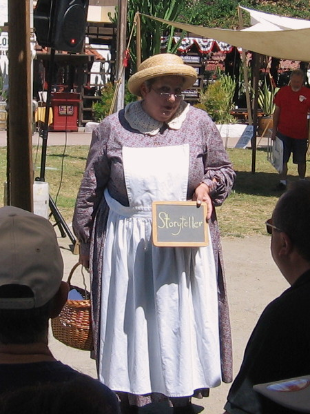A storyteller making the rounds at TwainFest asks the audience between musical performances to solve humorous riddles.