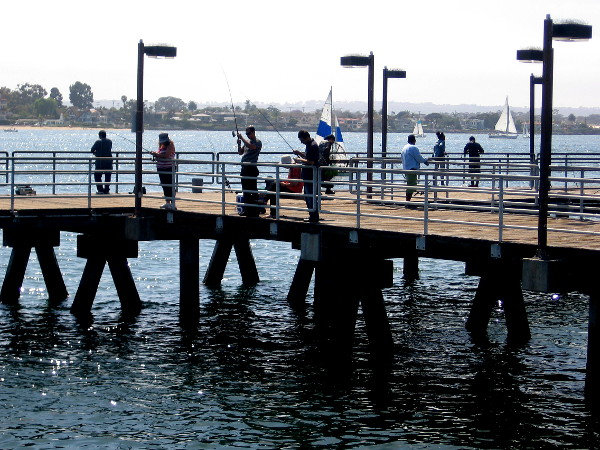 The small pier is a favorite spot for fishermen and families, especially on weekends and during the summer.