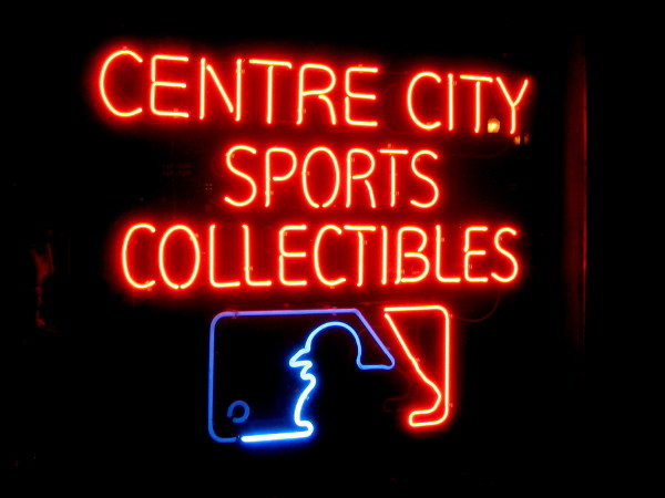 Cool neon sign in shop window of Centre City Sports Collectibles.