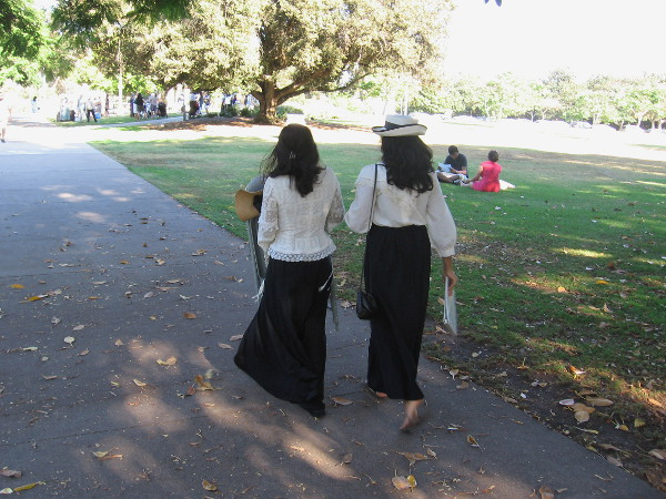 Two women head for Sefton Plaza in Balboa Park, where a suffrage rally would celebrate the anniversary of the 19th Amendment.