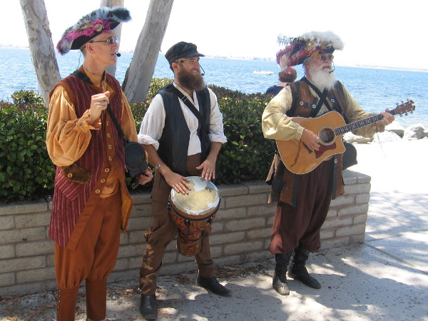 These gents in festive old-fashioned costumes were providing music in one corner of the park by the water.