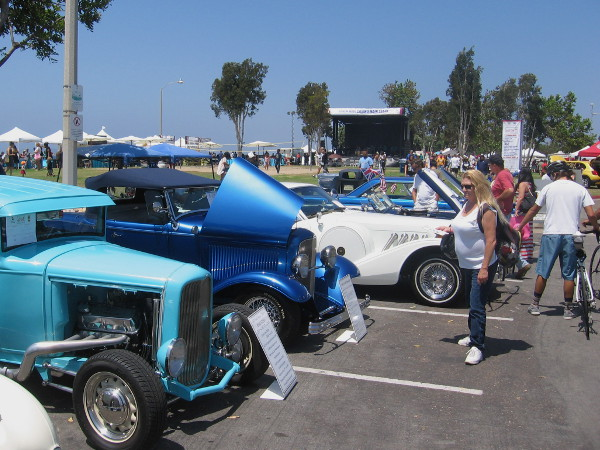 A cool car show had a bunch of hot rods and vintage automobiles out on display.