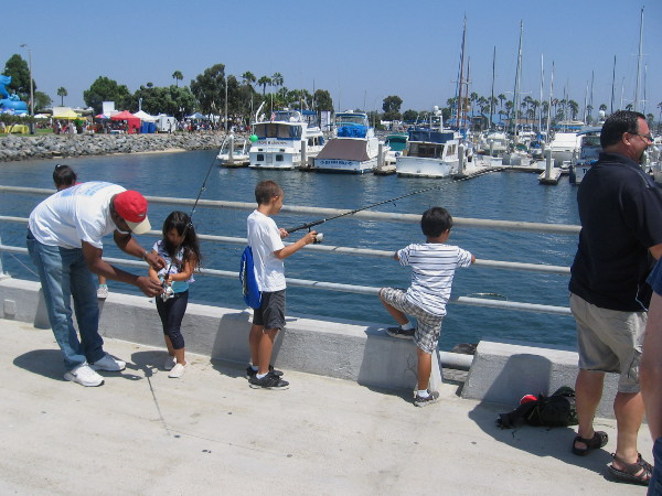 These young fishermen are enjoying the water and a view of the Chula Vista Marina.