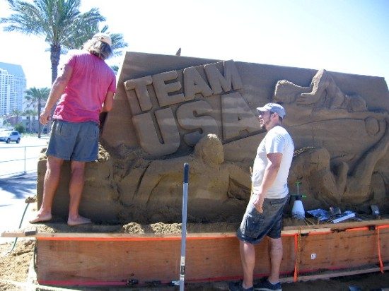 Dan Belcher from St. Louis, Missouri and Ilya Filimontsev from Moscow, Russia, work together on the big event's welcoming Team USA sand sculpture.