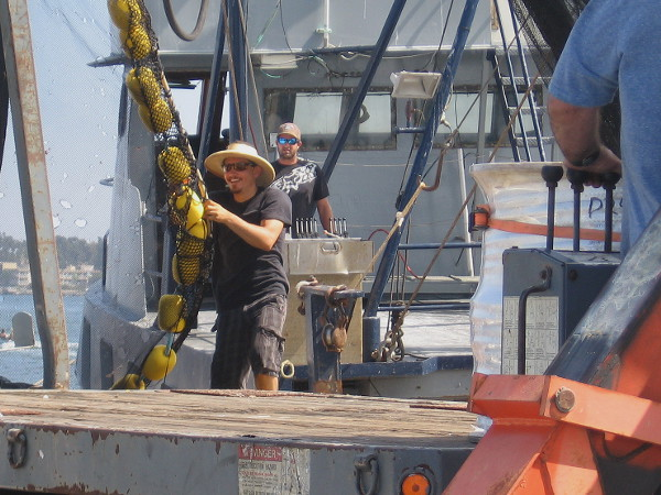 Working with a smile on a sunny summer Saturday on San Diego's busy Embarcadero.