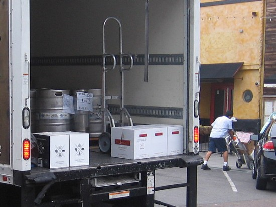 Typical early morning deliveries in Little Italy include kegs of beer and boxes of spirits.
