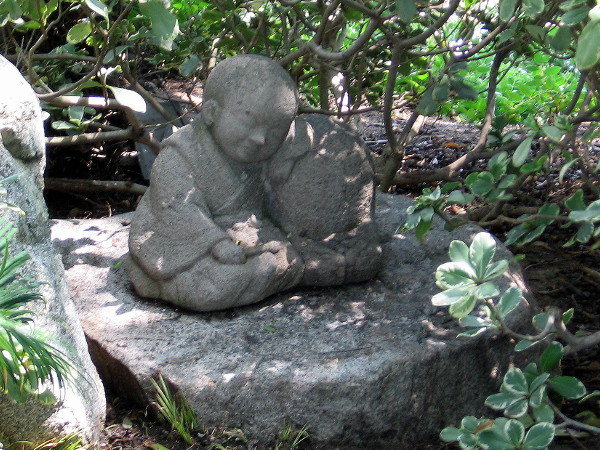 This small sculpture of a child is a mystery. One of the groundskeepers told me that. It might be a young Buddha, or an infant who tragically died. No one seems to know its history.