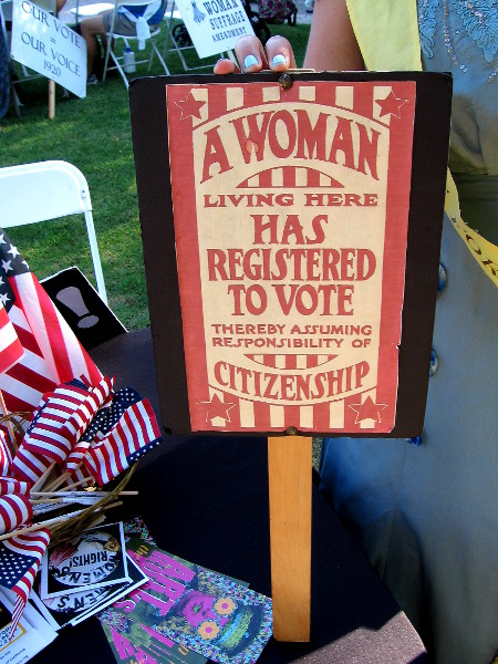 Historical sign proclaims a woman living here has registered to vote thereby assuming the responsibility of citizenship.