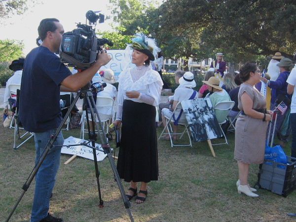 In period attire, the person being interviewed played the role of San Diego philanthropist and trailblazer Ellen Browning Scripps during the rally.