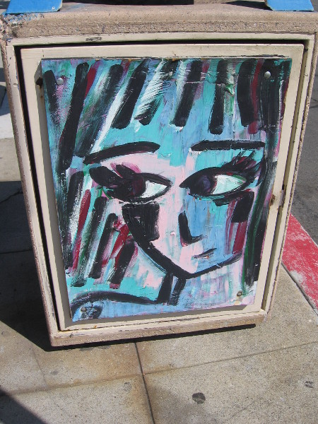 A female face painted on a La Jolla garbage container.