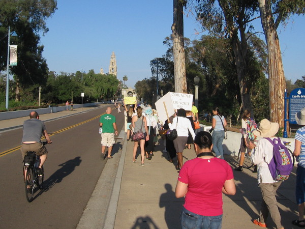 The suffrage parade begins toward the heart of Balboa Park, down El Prado and over the Cabrillo Bridge.