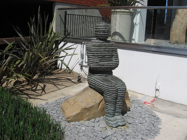 Unusual human sculpture sits near the sidewalk outside La Jolla's Madison Gallery.