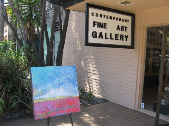 A canvas out on public display in front of the Contemporary Fine Art Gallery in the central business area sometimes called Village of La Jolla.