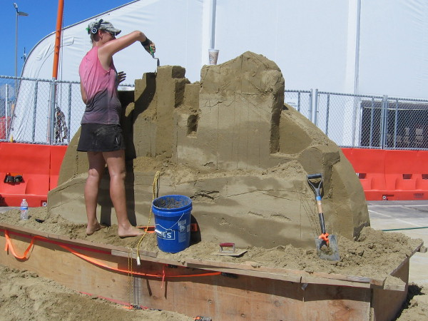 Susanne is carefully working on another cool sand sculpture for event visitors. I can't wait to see what she produces during the competition!