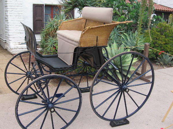 A ladies basket trap carriage, circa 1900. This simple horse-drawn vehicle was often used for comfortable country travel, complete with wicker basket seat.