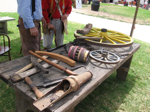 The wheelwright had many tools on display and explained how wheels in the 19th century were skillfully created of wood and iron.