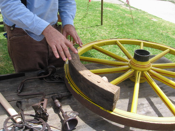 A welded ring of bent iron would be expanded with heat, then placed around the wheel's ash wood circumference.