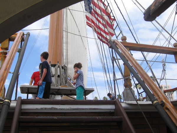 Kids walk up onto Star of India's high poop deck. Perhaps the eyes of youth, probing the horizon, can discern the strange wonder of Moby Dick.