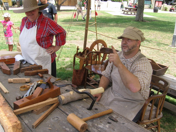 A cool woodworker demonstrates and provides the names of his many tools to the delight of watching kids.