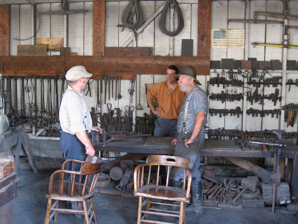 A sneaky peek into the blacksmith shop behind Seeley Stable Museum before the event officially begins outside in the plaza.
