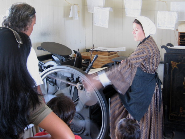 Printing press demonstration underway at the San Diego Union Museum print shop in Old Town.