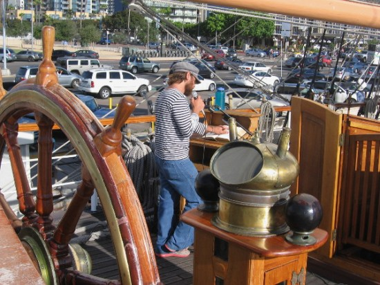 Steering wheel and binnacle, instruments of navigation used by generations of restless, active seafaring men.